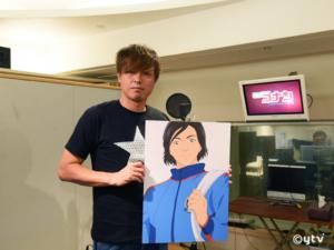 ご自分のキャラクターパネルを持ったガンバ大阪・遠藤保仁選手